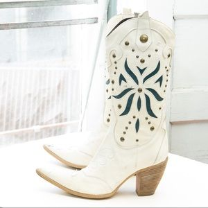 Melin heeled western boot; wingtip, inlay, studded
