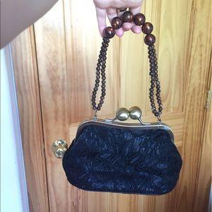 Beaded handle black lace purse