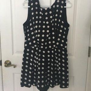 Black and white polka-dot romper