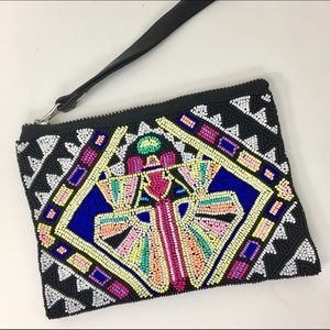Mara Hoffman Handbags - Mara Hoffman beaded black leather wristlet.