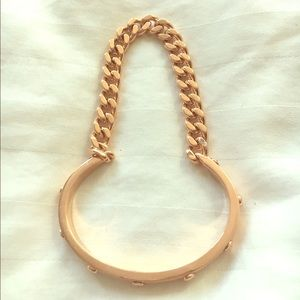 Henri Bendel's rosegold bangle and chain bracelet