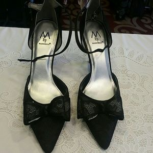 Beautiful black lace  heels with bow. Size 9.5