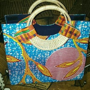 African wooden handle Tote Bag