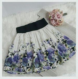 A. Byer Dresses & Skirts - Purple Floral Black Stretch Band Mini-skirt