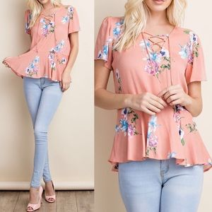 Pink Peplum Boutique Tops - 🆕 Peach blush floral woven top w lace up V-neck