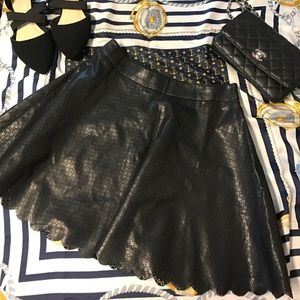 Scalloped chic circle skirt faux leather