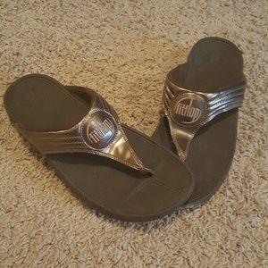 Fit Flop patent bronze sandals