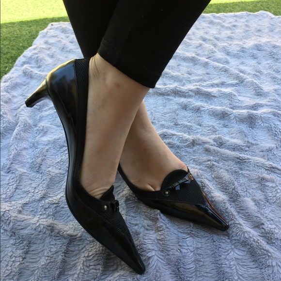 f38b0e66fa7 M 58fa71c6a88e7dd915018db5. Other Shoes you may like. Prada pumps. Prada  pumps.  650  800. PRADA Patent Black Leather Heels