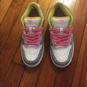 Pink, yellow and gold Nike Dunks.