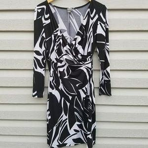 Muse Dresses & Skirts - Muse black white long sleeve wrap dress