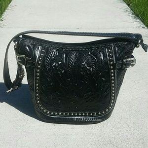 American West Handbags - American West black tooled leather bucket bag.