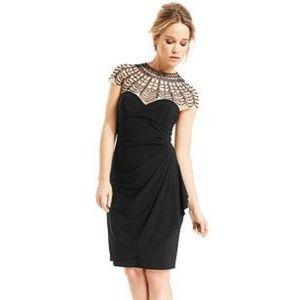 Xscape Dresses & Skirts - Black Beaded Illusion-Neckline Cocktail Dress