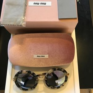 Miu Miu Accessories - Miu Miu round very collectible sunglasses.