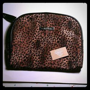 Calvin Klein Handbags - CALVIN KLEIN CHEETAH MAKEUP BAG