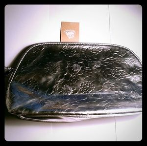 Vera Wang Handbags - VERA WANG SILVER MAKE UP BAG WITH TAG