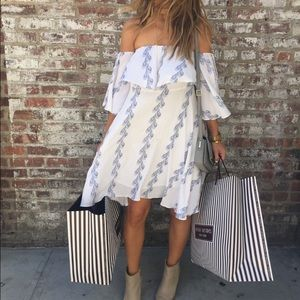 Chicwish  Dresses & Skirts - White Off the Shoulder Dress w Blue Feather Print