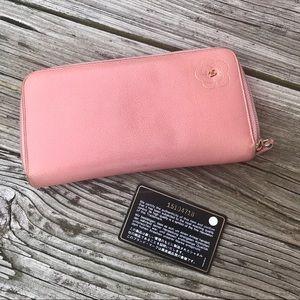 CHANEL Handbags - Chanel Camellia Long Zippy Clutch Wallet