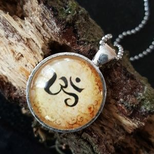 Jewelry - Om healing vibration silver glass necklace nwt