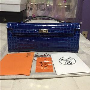Hermes Handbags - HERMES blue clutch
