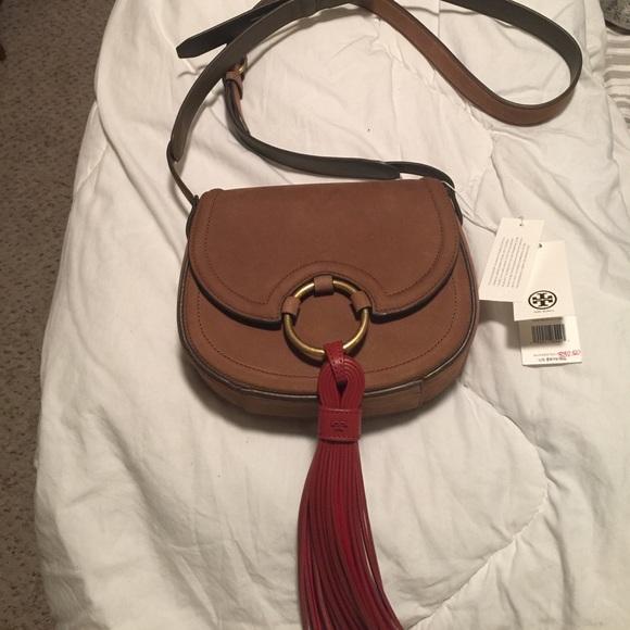 def050950d6 Tory Burch Tassel Mini Saddle bag. M 58ffc377fbf6f98aa201d2a3