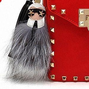 Chanel's Karl Lagerfeld Charm
