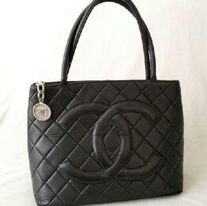 CHANEL Handbags - Authentic Chanel Black Lambskin Medalion Tote Bag