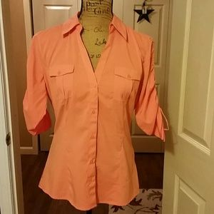 Tangerine colored silky blouse with tie up sleeves