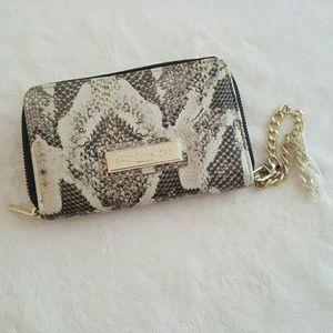 Olivia + Joy Handbags - NWT Olivia + Joy python wristlet