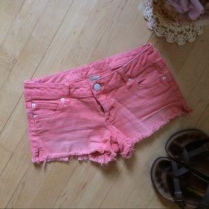 refuge Pants - Faded coral cutoff jean shorts