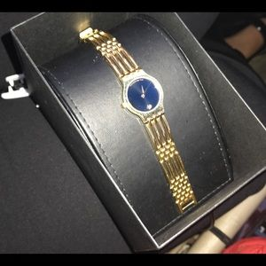 GOLD MOVADO WACH Would totally compromise $