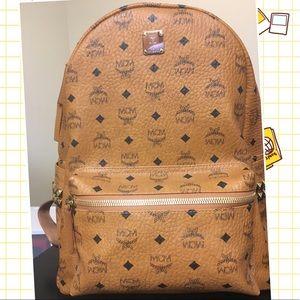 MCM Handbags - NWT MCM Stark Medium Backpack