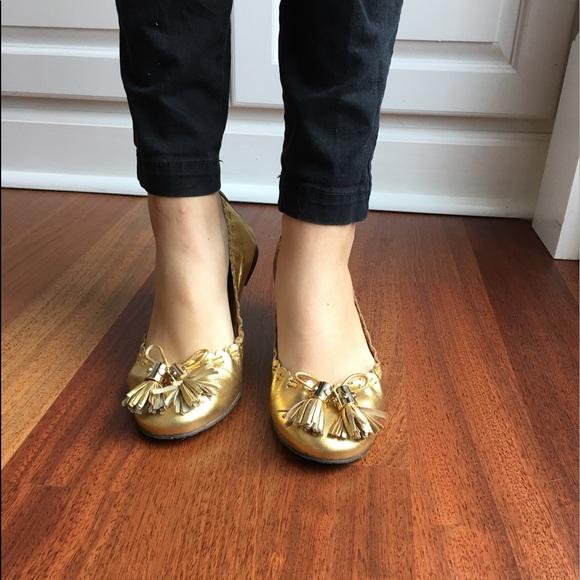 665a94bb2 tory burch gold metallic reese tassel ballet flat.  M 5901e5a34225bebc22000cf1