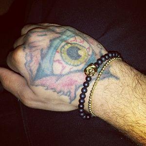Matte black bead gold rose bracelet