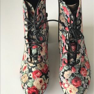 Floral print combat Boot inspired lace up boots.