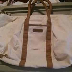 Norma Kamali Handbags - Large oversized tan Norma Kamali handbag