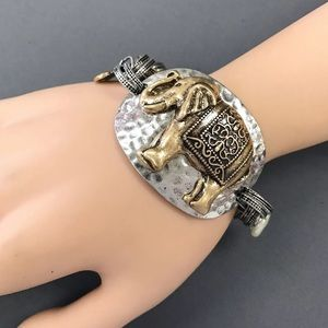 Story Jewelry - Unique bohemian silver/gold hammered elephant brac