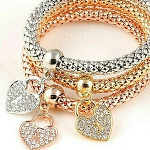 Jewelry - Set of 3 bracelets white, yellow and rose tone gol
