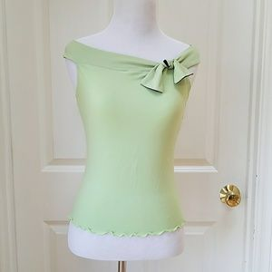 Amy Byer green formal top.