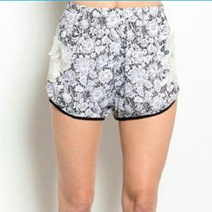 Pants - Chic floral print shorts.