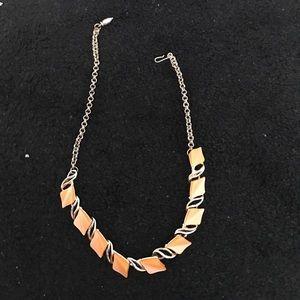 Vintage necklace hangs to collar bone color gold