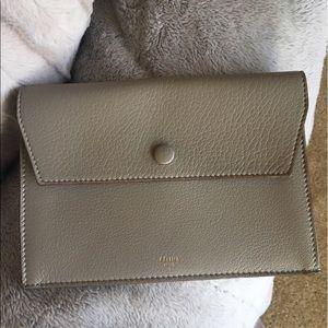 Celine Handbags - Authentic  Celine pebbled Pouch never used .