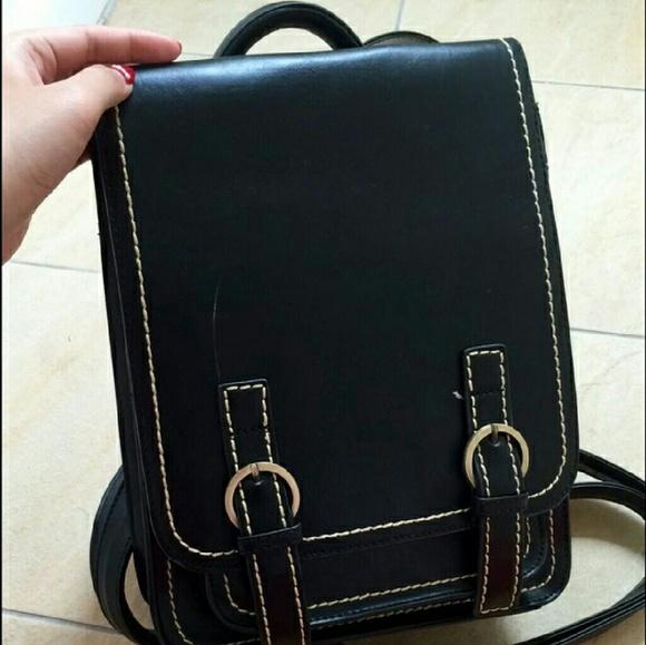 Black hard leather backpack OS from Christina's closet on Poshmark