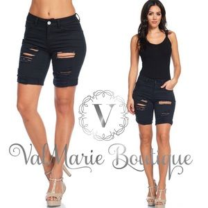 Destroyed black denim Bermuda shorts