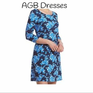 AGB Dresses & Skirts - AGB floral swing style midi dress!