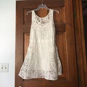 Lined white lace fit and flare mini dress