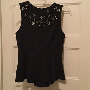 NWT Forever 21  Black Peplum Top. Size medium.