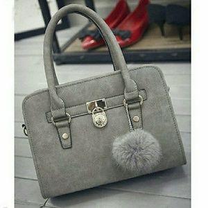 Handbags - NWT HANDBAG WITH POM POM