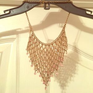 Gold and pink bib necklace.