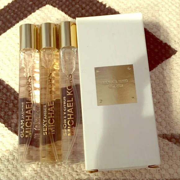 d56c9ce6419b Michael Kors Other - Michael Kors fragrance trio purse travel sprays