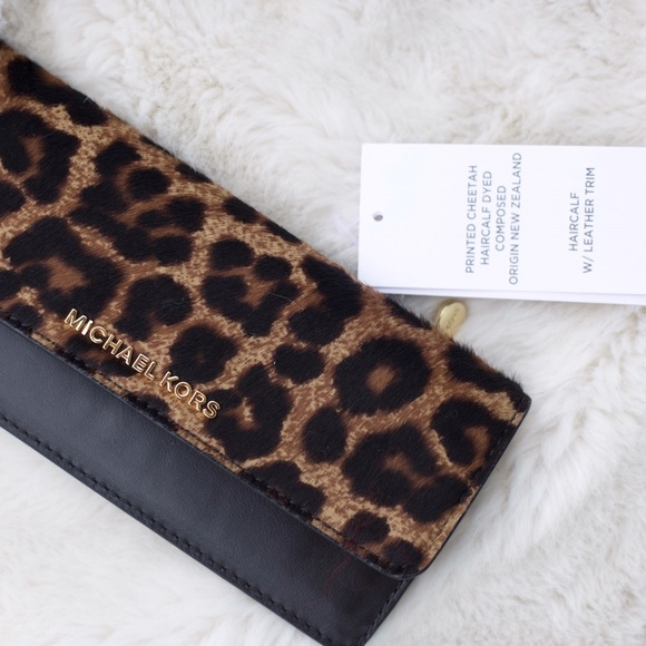 9aa833249a44 MK leopard calf hair jet set travel wallet. M_59372a6f4e95a33e4a046f3c